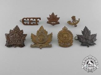 A Lot of Seven Royal Canadian Military Cap Badges and Uniform Insignia