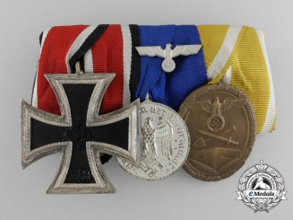 A Mint Iron Cross, Long Service and West Wall Medal Bar