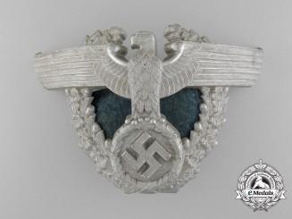 A German Police Officer's Shako Eagle Helmet Plate