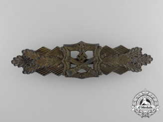 A Bronze Grade Close Combat Clasp by A.G.M.u.K.