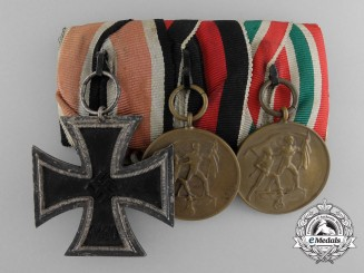A Second War German Medal Bar with Memel Medal by Juncker