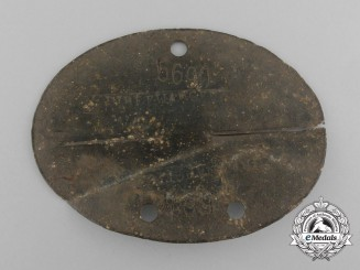 A Second War Ground Found Identification Tag