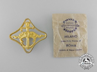 Italy, Fascist State. A Royal Navy Battleships War Navigation Badge with Packet