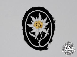 An Unworn Waffen-SS Gebirgstruppen Edelweiß Sleeve Patch