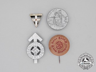 A Grouping of Four Third Reich Period German Pins and Badges
