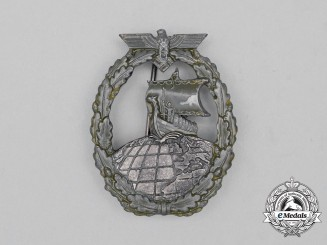 A Second War German Kriegsmarine Auxiliary Cruiser Badge by Rudolf Souval of Vienna