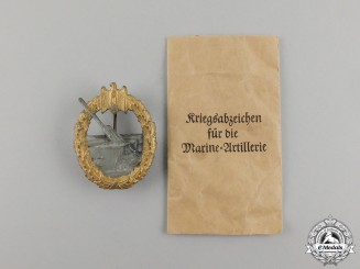 Germany, Kriegsmarine. A Coastal Artillery War Badge by Sohni & Heubach in Packet of Issue