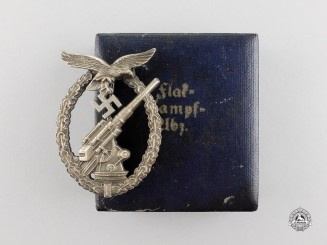 An Early War Luftwaffe Flak Badge by Juncker in its Case of Issue