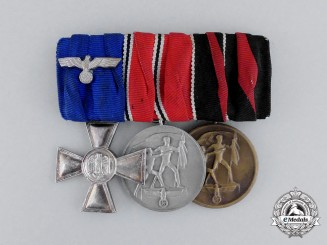 Germany. A Wehrmacht 18-Year Long Service & Campaign Medal Bar