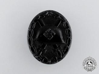 A Second War German Black Grade Wound Badge with Miniature Stickpin