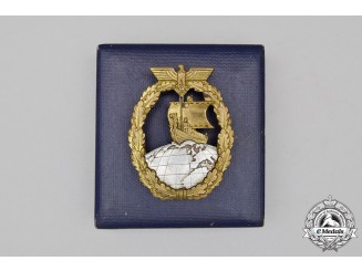 A Second War German Kriegsmarine Auxiliary Cruiser Badge in its Case of Issue