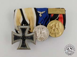 A Second War German Iron Cross 1939 Second Class and Luftwaffe Long Service Medal Bar