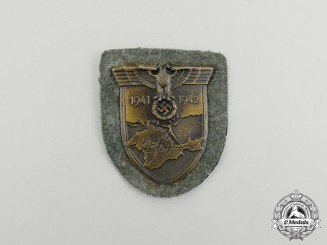 A Wehrmacht Heer (Army) Issue Krim Campaign Shield by Josef Feix & Söhne; Dated