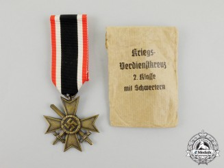 A War Merit Cross Second Class with Swords by H. Kreisel in its Packet of Issue