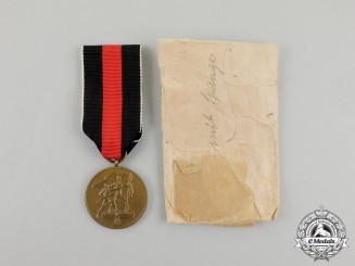 An Entry into the Sudetenland Commemorative Medal in its Packet of Issue