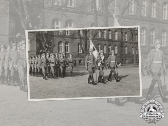 Germany, Heer. A Wartime Period Photo of a Marching Infantry Unit with Flag Bearer