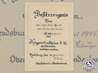 An Award Document for a War Merit Cross 2nd Class with Swords to Medical Orderly Erich Arndt