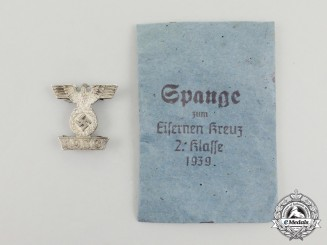 Germany. A Clasp to the Iron Cross 1939 II Class, Type I in its Packet of Issue, by Frank & Reif