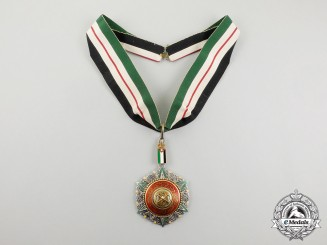 A Jordanian Order of Al Nahda; Commander 3rd Class with Case by GARRARD & Co Ltd