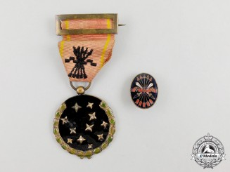 A Spanish Fascist Party Member's Medal and Lapel Badge