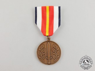 A Norwegian Medal for Defence Service Abroad on a Balkans Service Ribbon