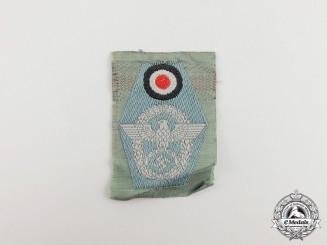 A Mint & Unissued German Police/Gendarmerie Overseas Cap Insignia