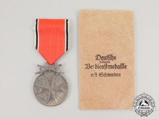 "A Mint Order of the German Eagle; Silver Merit Medal with Swords by ""Munzamt. Wien"" in Pocket of Issue"