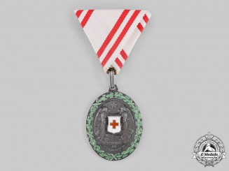 Austria, Imperial. A Red Cross Honour Medal, II Class with War Decoration, by Rudolf Souval