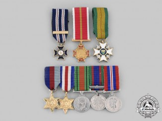 Canada, Rhodesia, International. A Lot of Eight Miniature Medals