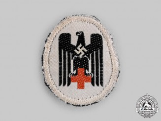 Germany, DRK. A Deutsches Rotes Kreuz (German Red Cross) Uniform Cap Insignia