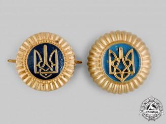 Ukraine. Two General Government Police Cap Badges, c.1942