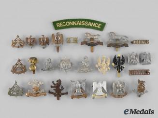United Kingdom. A Lot of Twenty-Five British Army Badges and One Shoulder Flash