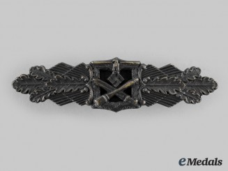 Germany, Wehrmacht. A Close Combat Clasp, Bronze Grade, by C.E. Juncker