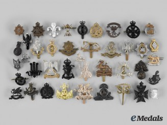 United Kingdom. A Lot of Forty-One Cap and Collar Badges