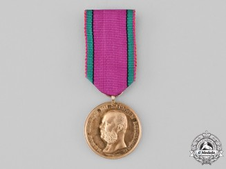Saxe-Altenburg, Duchy. A Saxe-Ernestine House Order, Golden Merit Medal by Friedrich Ferdinand Helfricht