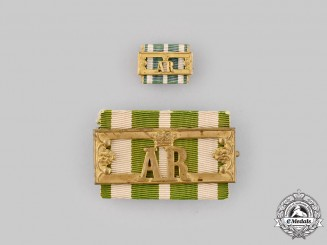 Saxony, Kingdom. A Landwehr Long Service Clasp, II Class, with Miniature