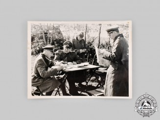 Germany, Wehrmacht. A Photograph of Wehrmacht Officers in the Field
