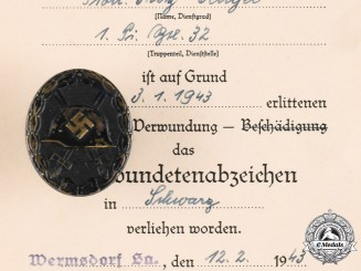 Germany, Wehrmacht. A Wound Badge, Black Grade, with Award Document to Fritz Mengel