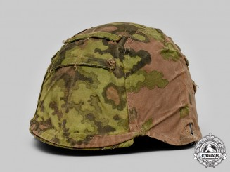 Germany, SS. A Waffen-SS B-Pattern Oak Leaf Camouflage Helmet Cover