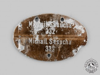 Germany, Kriegsmarine. An Eastern Legionnaire Identity Tag to Michail Sasucha