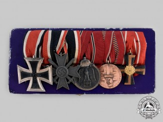Germany, Wehrmacht. An EK & Finnish Liberty Cross Medal Bar with Case