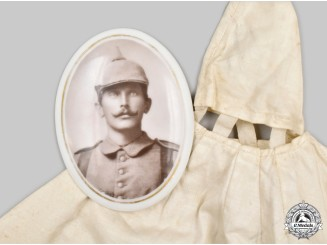 Germany, Imperial. A Pickelhaube Winter Camouflage Cover, with Memorial Portrait