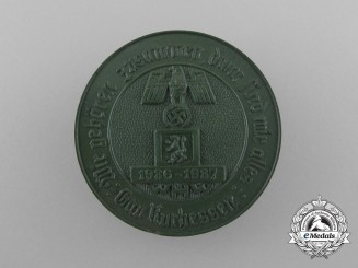 "Germany. A 1937 Winter Relief of the German People ""We Belong Together; Then we are One"" Badge"