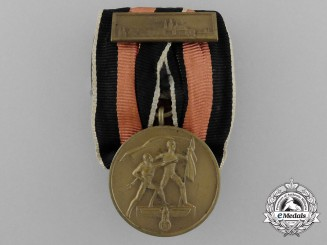 A Commemorative Sudetenland Medal with Prague Bar