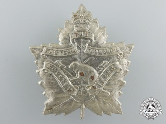 A First War Eastern Townships Mounted Rifles Cap Badge