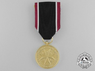 An Order of St.John Life Saving Medal; Gold Grade