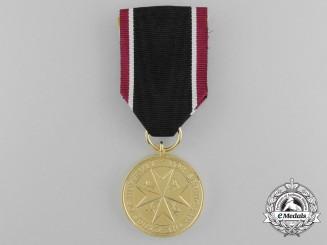 An Order of St.John Life Saving Medal; Gold Grade