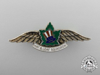A Rare American & Canadian Second War Hat & Leaf Squadron Membership Badge