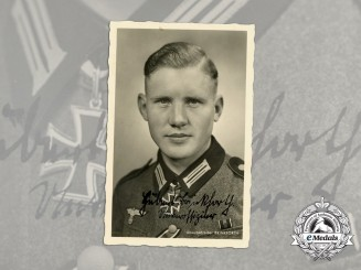A Wartime Signed Picture Postcard of the First Enlisted Man KC Recipient
