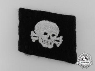 """An SS Totenkopf Skull Collar Tab; """"Pumpkin Head Pattern"""""""